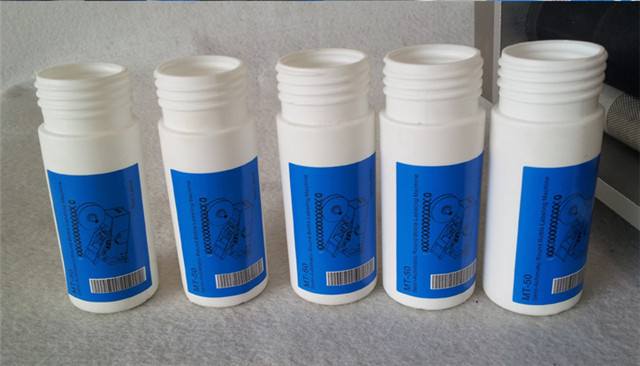 labelled samples by semi automatic round bottle labeling mac