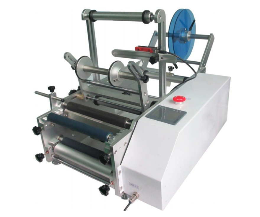 close up photo of red wine bottles labeling machine.jpg