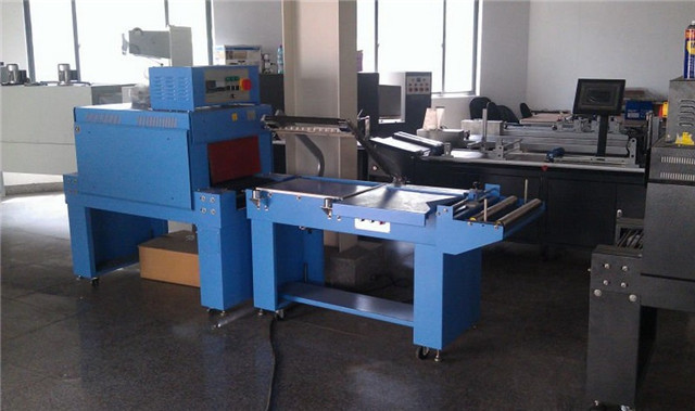 heat tunnel shrink wrapping machine at workshop.jpg