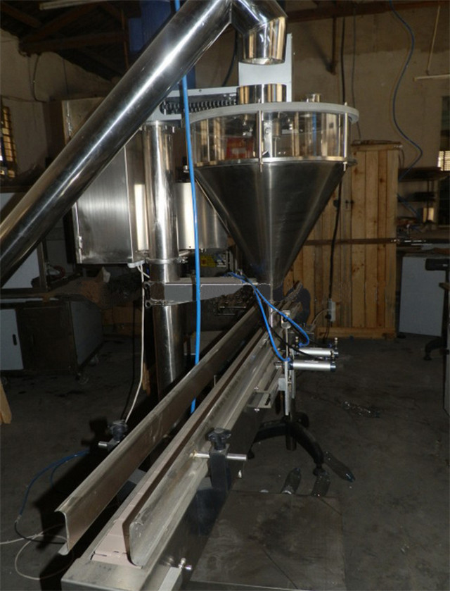 close view of auger metering filling packing machine.jpg